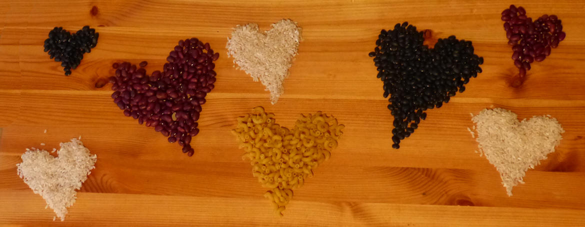 Handfulls of rice and legumes shaped into hearts